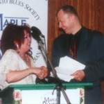 Drummer of the Year Maureen Brown (L) is congratulated by emcee John Northcott.