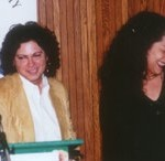 Female Vocalist of the Year Rita Chiarelli (L) shares a laugh at the podium with presenter Molly Johnson.